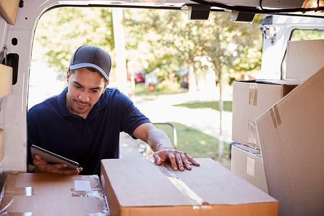 Courier looking for package in van